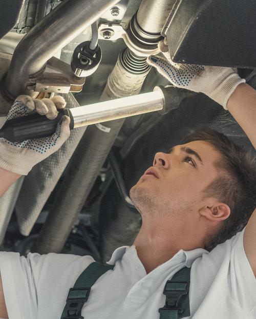 Mechanic looking under a vehicle - MOT & Service Folkestone, Dover