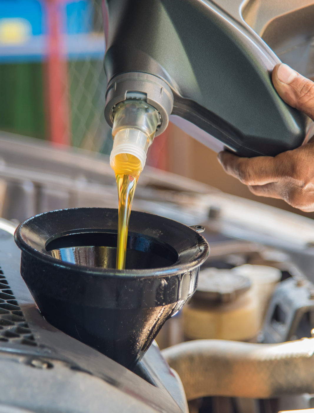 Mechanic pouring engine oil into an engine - MOT & Service in Folkestone & Dover